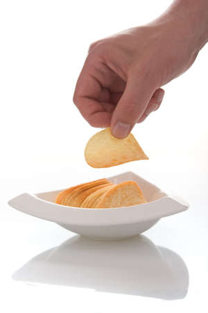 Fingers taking chips Stock Photo - 17405601