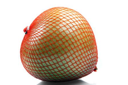 Pomelo in a net Stock Photo - 16971337