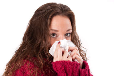Woman with a cold and handkerchiefs  Stock Photo