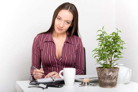 Woman planing her day after breakfast Stock Photo - 17415027