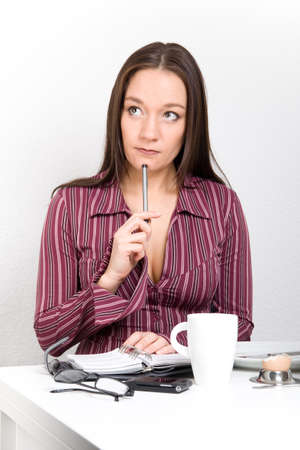 Woman planing her day after breakfast  Stock Photo - 17415026