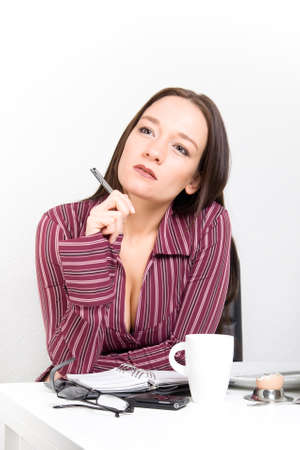 Young woman planing her day after breakfast  Stock Photo - 17415044