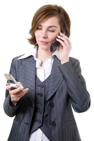 Business woman with two mobile phones Stock Photo - 17494996