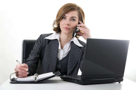Business woman with notebook, calendar and mobile phone at work