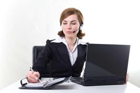Business woman with notebook, calendar and headset   photo