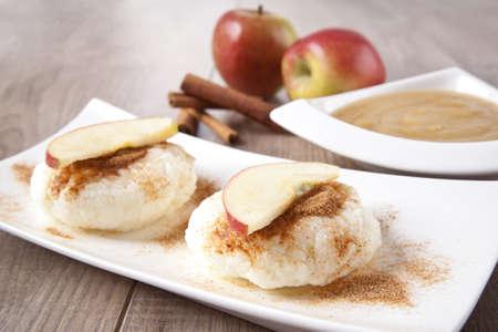 Rice pudding with cinnamon and apple sauce photo