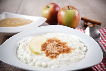 Rice pudding with cinnamon and apple sauce