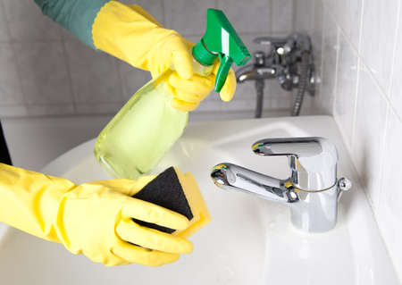 hogging: Woman cleaning the water tap