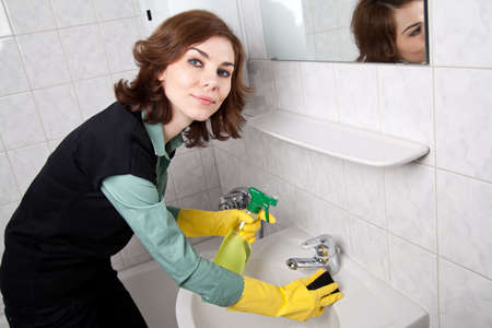 Woman cleaning the bathroom Stock Photo - 18359398
