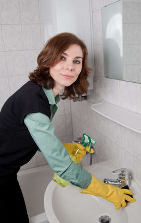 Woman cleaning the bathroom Stock Photo - 18359396