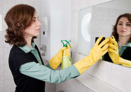 Woman cleaning the bathroom photo