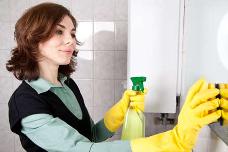Woman cleaning the bathroom