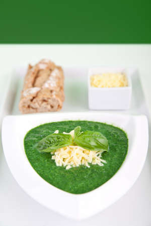 Fresh spinach and basil soup with baguette and cheese Stock Photo