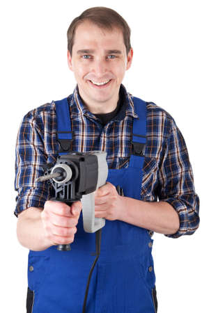 Smiling craftsman with drill machine photo