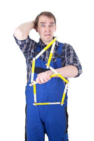 yardstick: Craftsman with yardstick Stock Photo