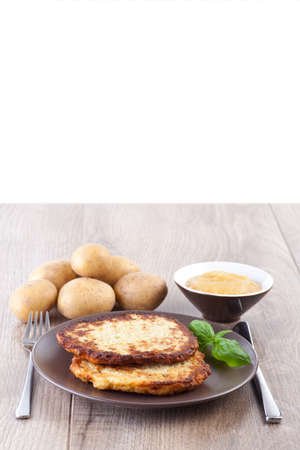 Potato pancake with apple sauce Stock Photo