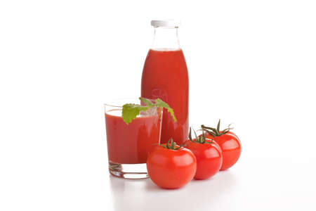 Tomato juice bottle and a glass Stock Photo