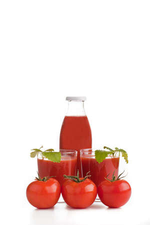 Tomato juice and two glasses Stock Photo