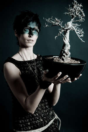 druid: Female druid with little tree