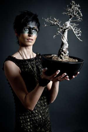 priestess: Amazon priestess with holy tree Stock Photo