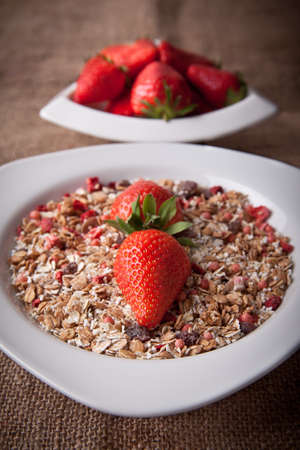 Muesli with fresh strawberries - avaiable light photo
