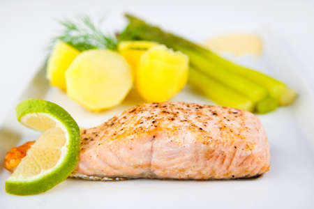Roasted salmon with green asparagus and potatoes photo