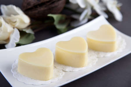 shea butter: Heart shaped body butter in pieces Stock Photo