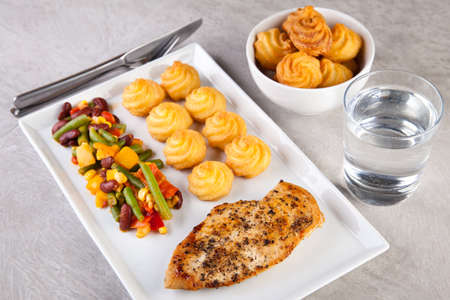 Chicken with duchess potatoes an vegetables