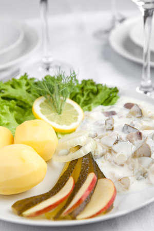 seafish: Cream herring with cucumbers, potatoes and salad