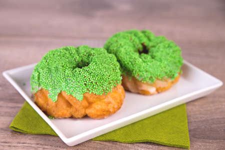 Spritz biscuits with green pearls Stock Photo