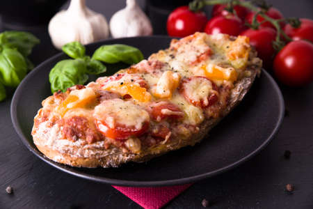 Rustic pizza bread with tomatoes and paprika Stock Photo