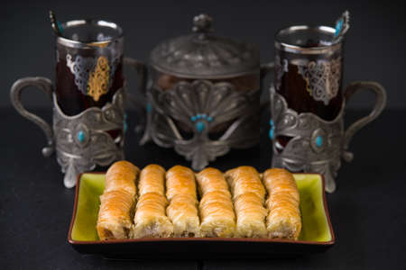 Baklava and black tea Stock Photo