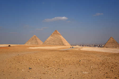 The pyramids of Giza are among the most famous pyramids of antiquity,they are considered one of the seven wonders of the ancient world.The pyramids were created in the ancient Kingdom of Ancient Egypt Reklamní fotografie