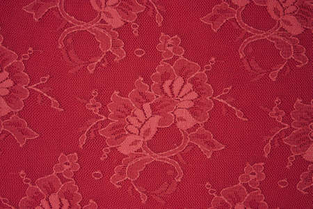 texture red lace fabric for the background photo