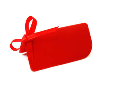 Red  blank gift or price tag on a white background photo
