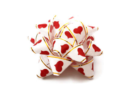 white ribbon with red hearts for the gift boxes photo