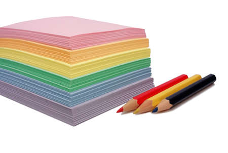 colored paper for notes and three pencils photo