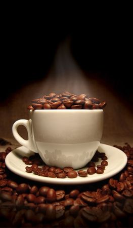 colombian food: Cup of coffee, full of beans. Stock Photo