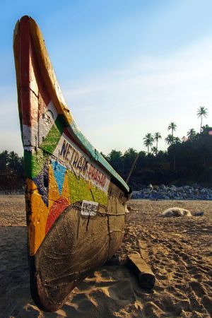 india fisherman: Indian boat painted with bright colors.                                Stock Photo