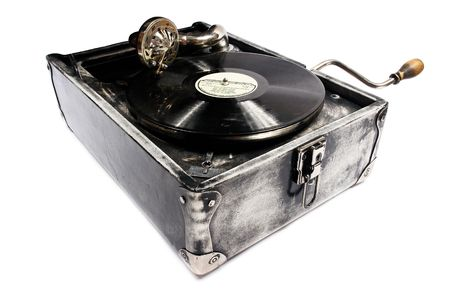 Exclusive retro gramophone in leather case. photo