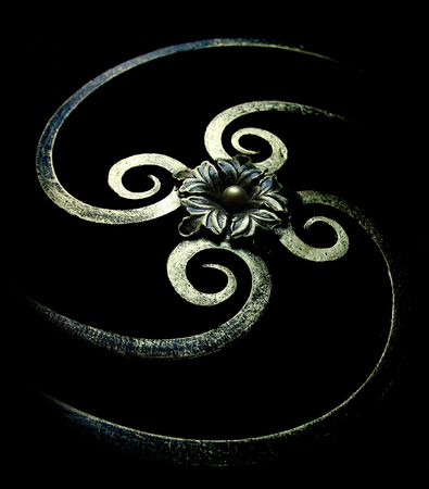 iron fence: Forged spiral decoration. Isolated on black.