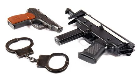 Two pistols, gun & handcuffs photo