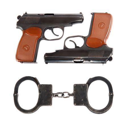 Two pistols & handcuffs photo