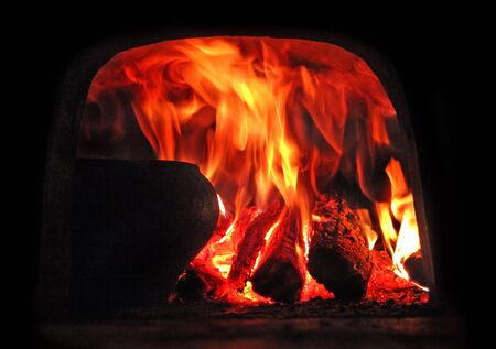 brazier: Traditional russian stove. Process of cooking.