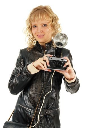 snapping fingers: Girl with old photo-camera. Isolated on white. Stock Photo
