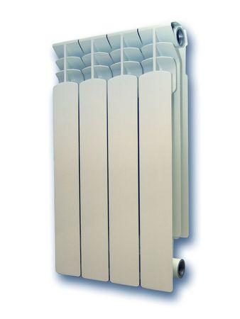 Aluminium radiator. 4 sections. Isolated on white.                          photo