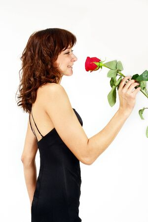 Girl in black with red rose. Isolated on white. Stock Photo - 2186175