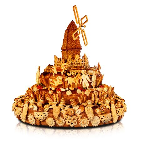 Dough art. Big cake with the windmill on the top. Russian bakery. photo