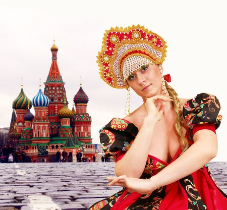 kokoshnik: Dancing girl in traditional Russian dress. Red square, Moscow. Stock Photo
