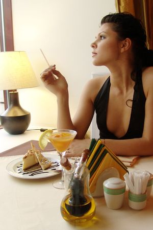 Girl in a restaurant interior. Served table.